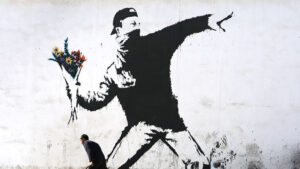Protesting with flowers by Banksy